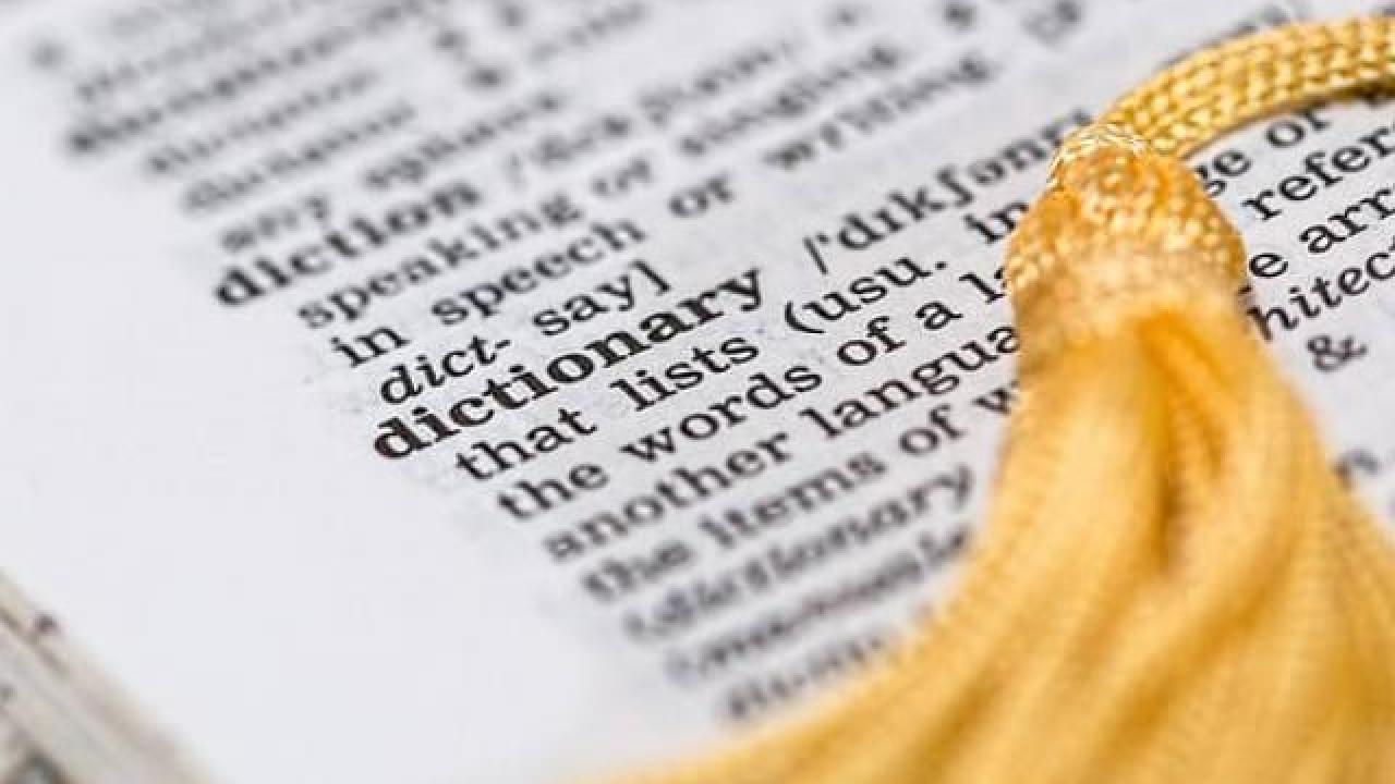 Dictionary with graduation stole